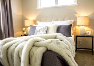 A home staged bedroom setting with perfect bedside lights.